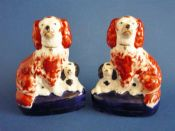 Pair of Staffordshire Pottery Spaniels and Pups on cobalt bases c1860